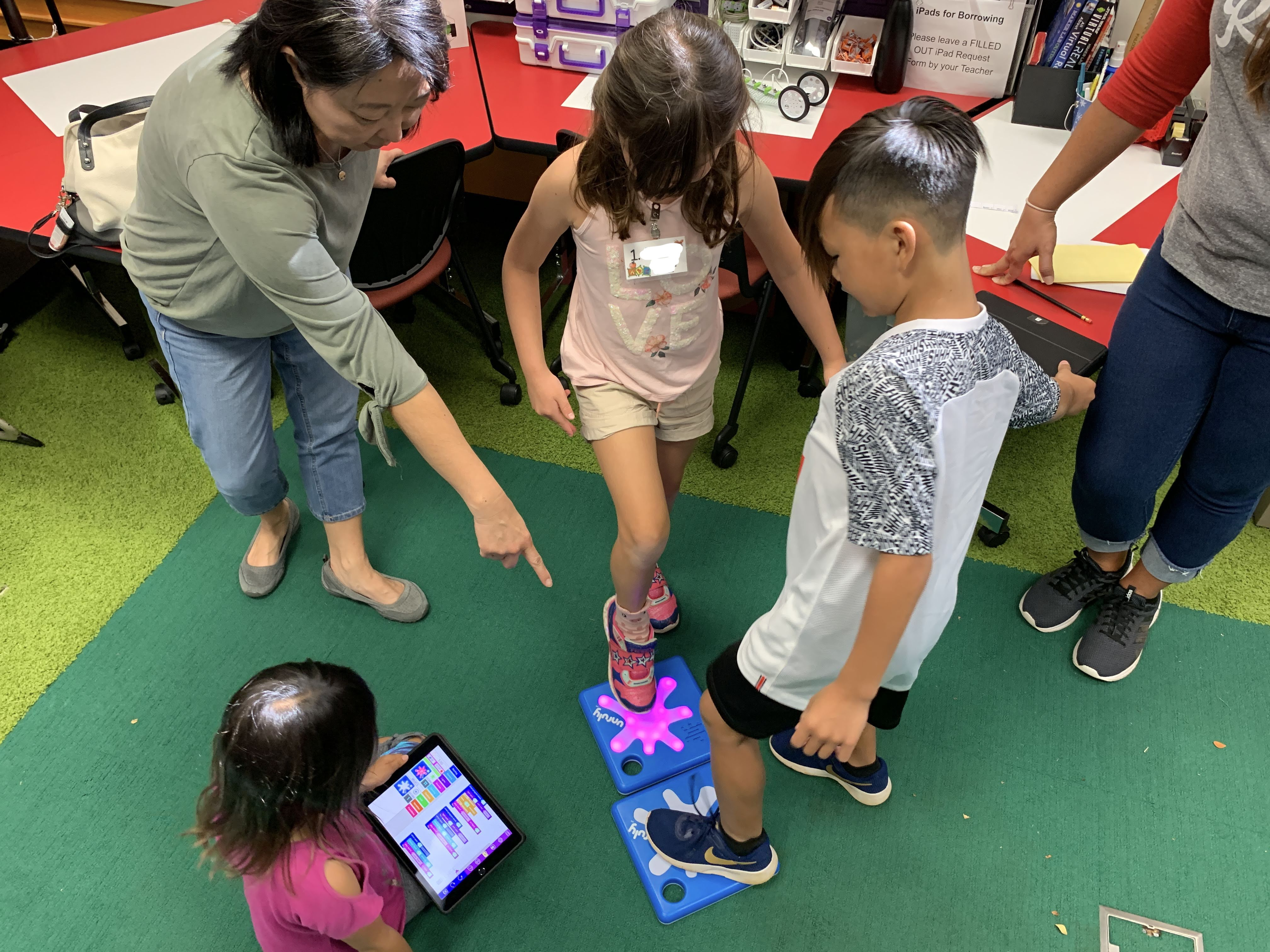 students engage in active STEM by stomping on Splats