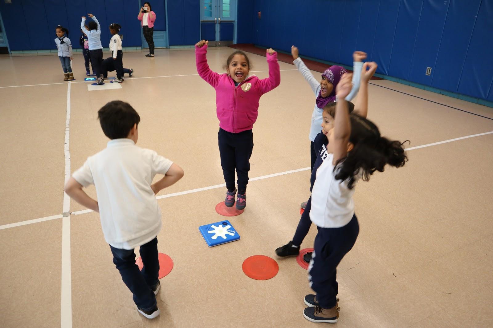 kids playing Unruly Splats STEM programs in elementary schools