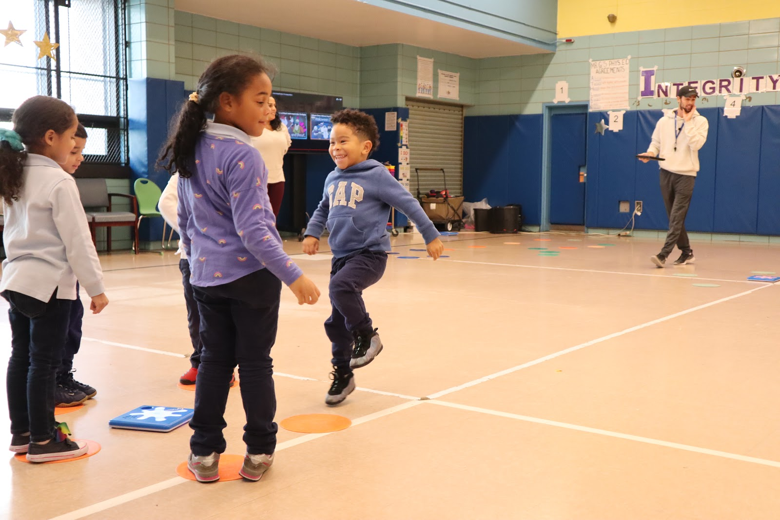 Kids Playing Active Games with Coding in PE Class