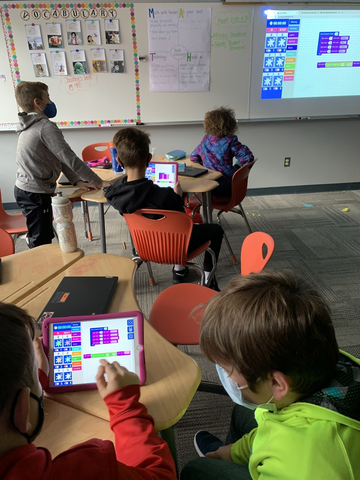Students learning block base coding as a part of their STEM Education