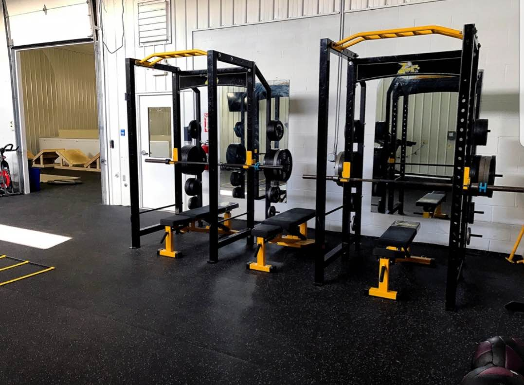image of our gym, free weights, squats, leg press, bench