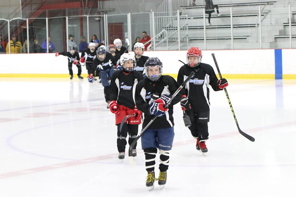 Image of a hockey player on the ice about to shoot a goal showing our circuit training programs