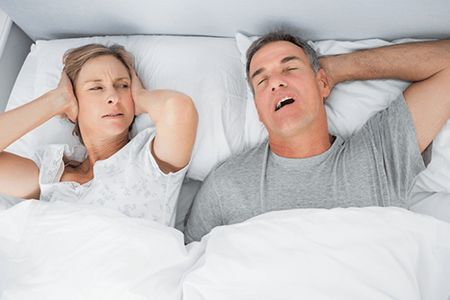 Couples suffering with sleep deprivation due to sleep apnea.