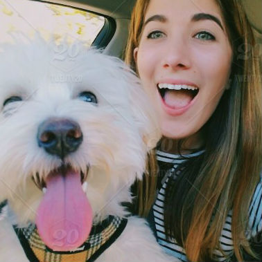 Woman with happy white dog
