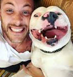 Man with happy white dog