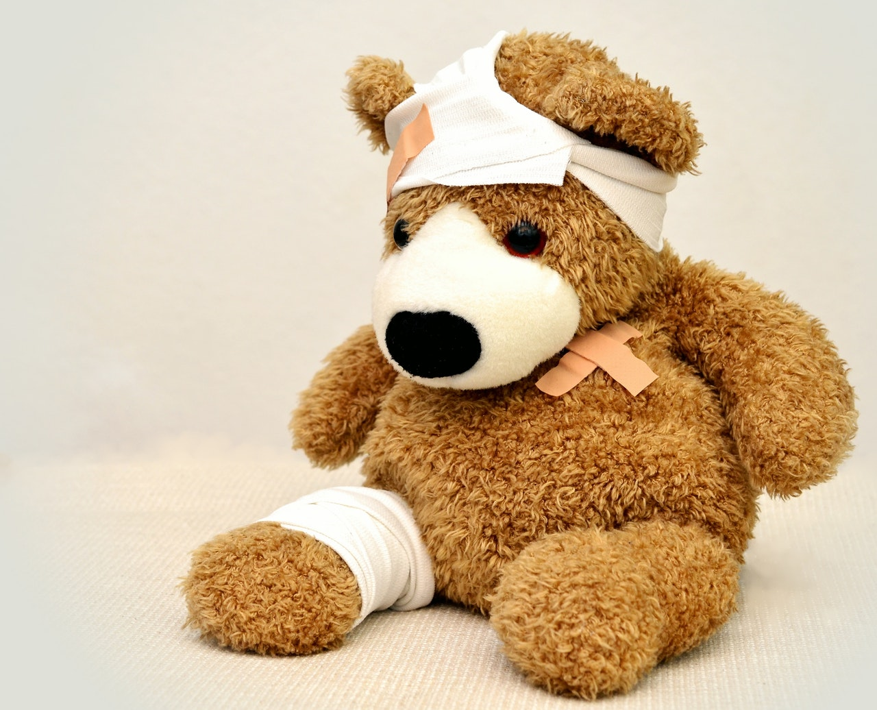 patched up teddy bear with bandages