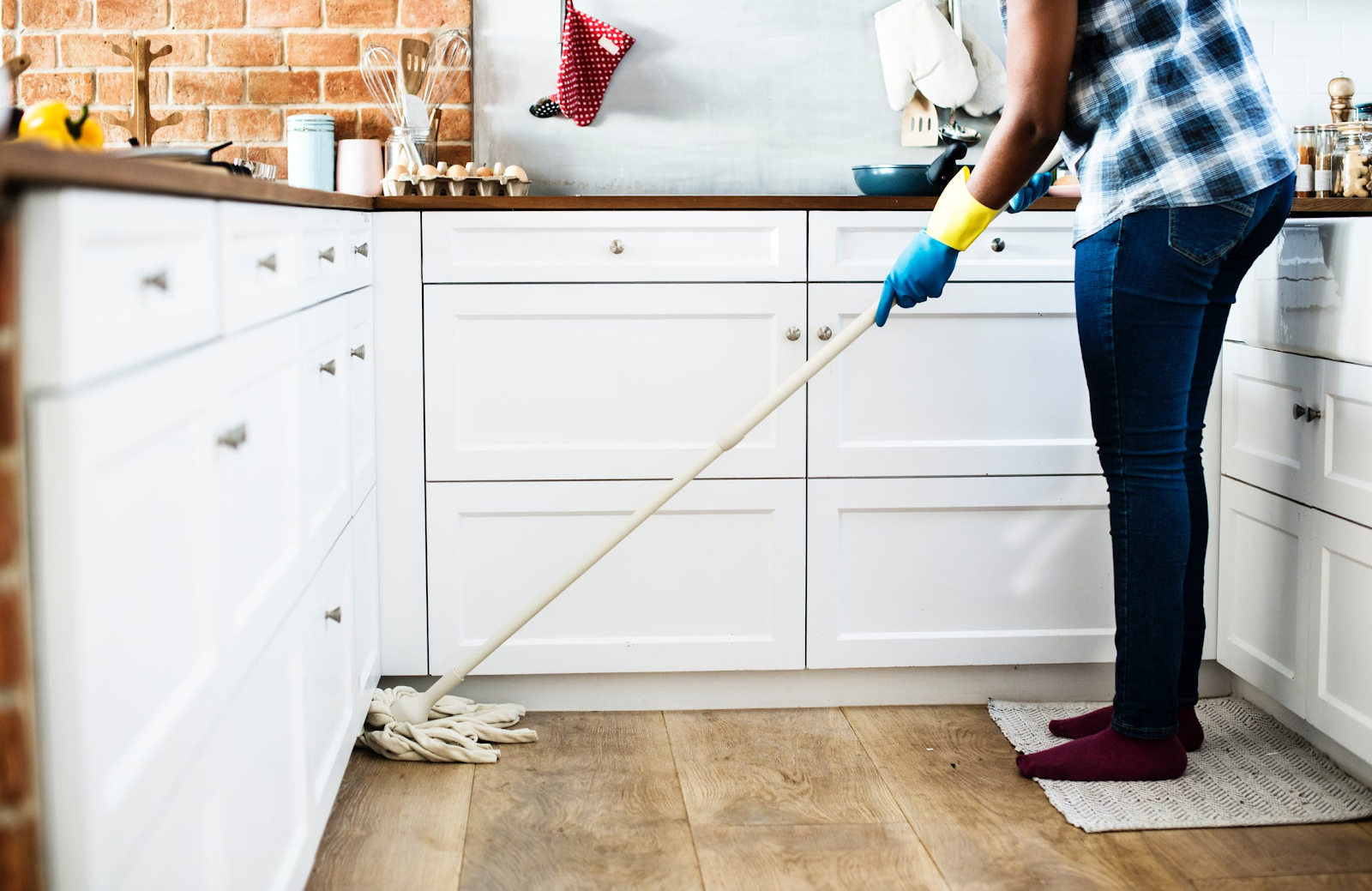 Cleaning the kitchen with a mop