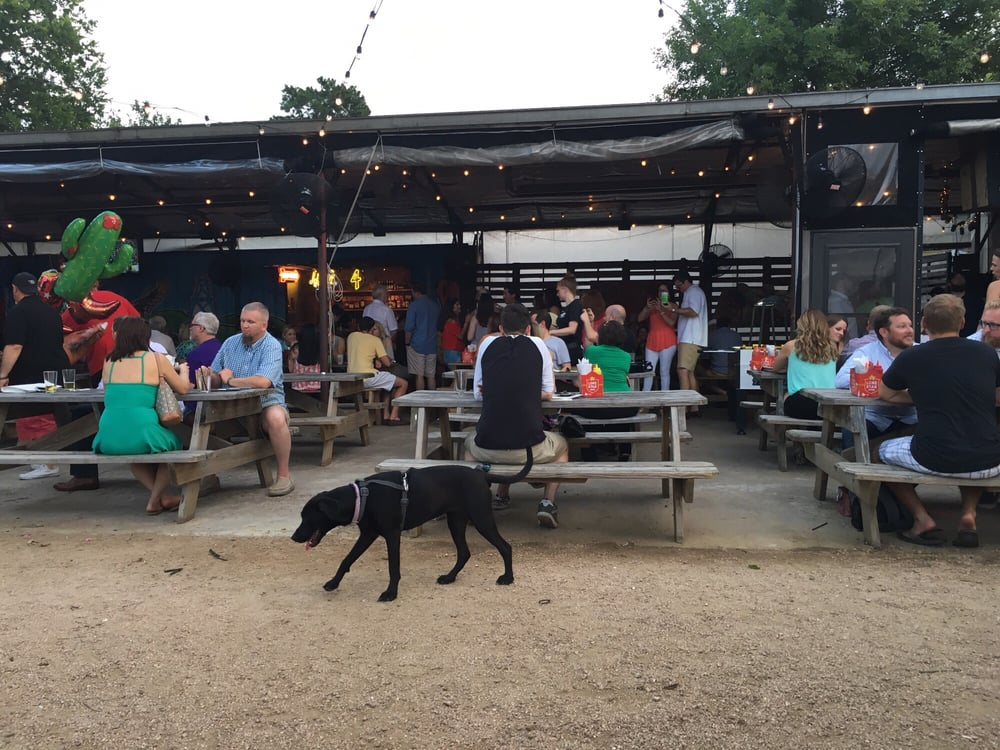 Cottonwood's patio with a dog