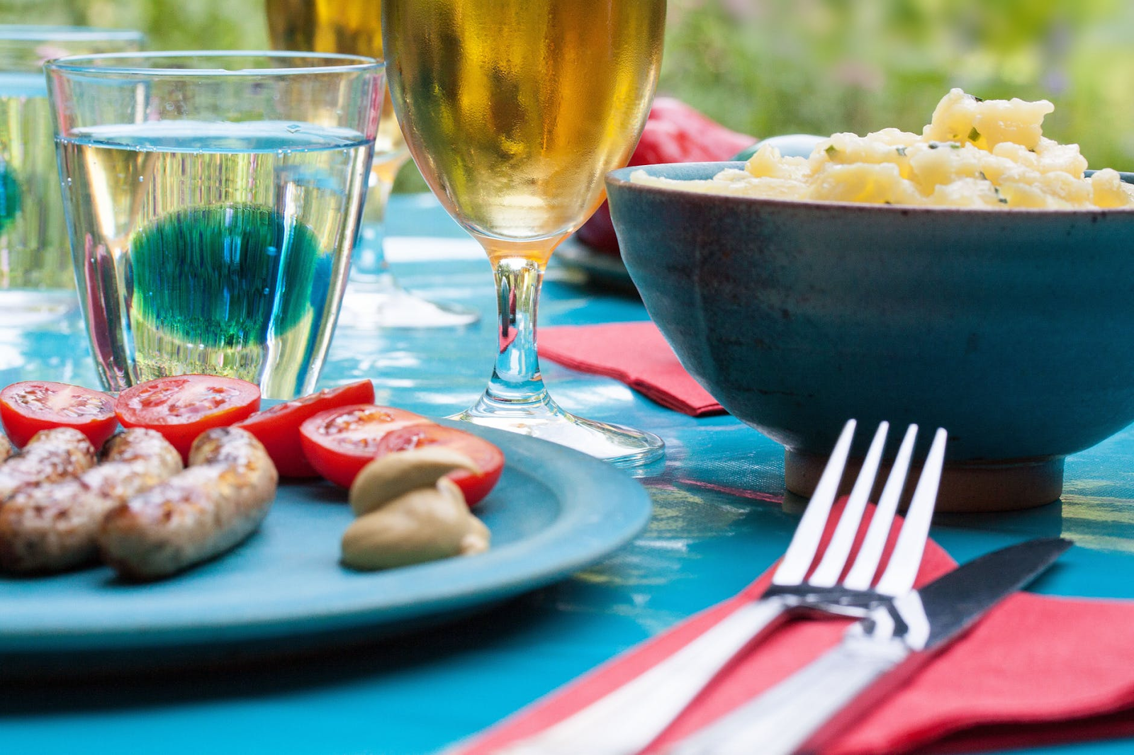A table showing a spread of summery foods and drinks