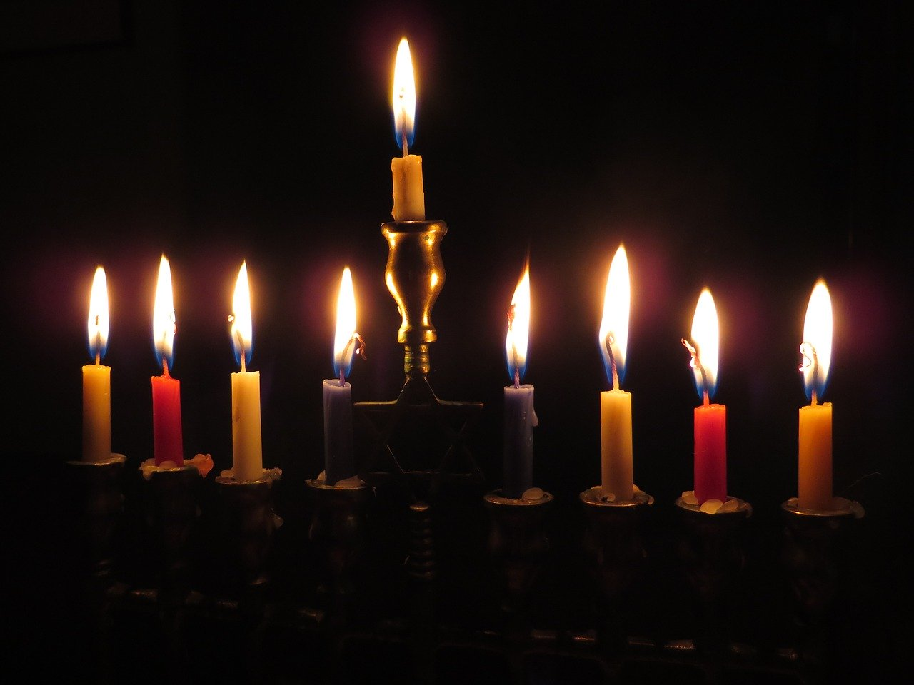 A menorah with all the candles lit