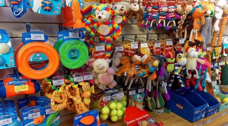 Wall full of brightly colored dog toys