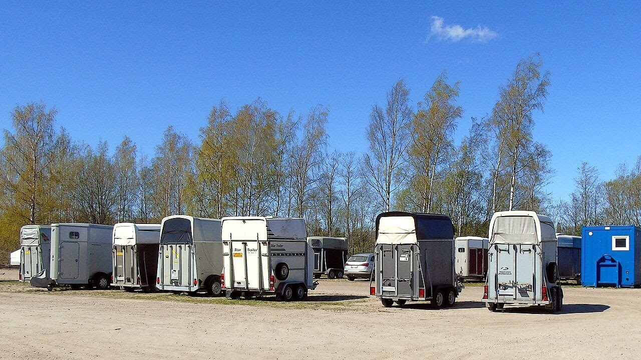 A row of horse trailers.