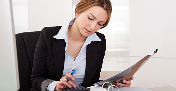 business woman using calculator