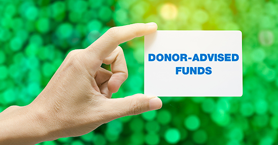 hand holding card that reads DONOR-ADVISED FUNDS