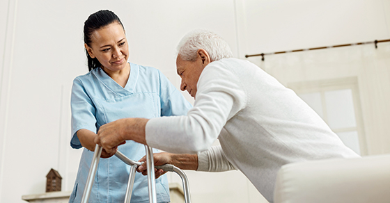 healthcare working helping senior patient