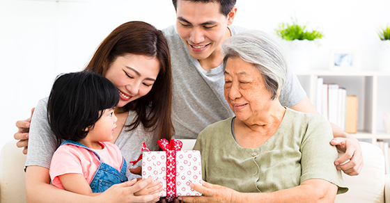 multi-generational family with gift