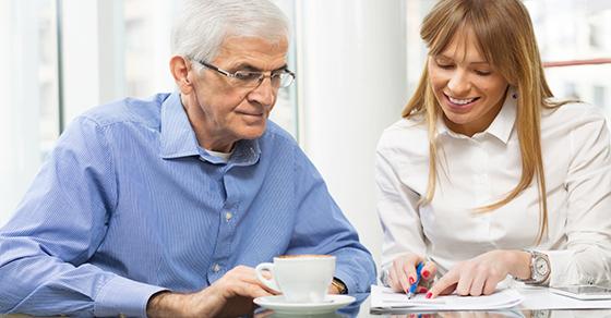 woman and older gentleman looking at paperwork
