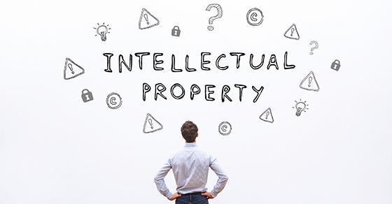 "man looking at ""intellectual property"" and symbols"