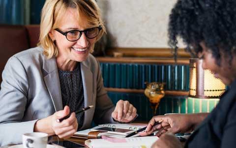 two women working on an estate plan