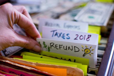 hand sorting through tax files