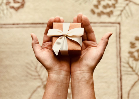 hands holding small gift