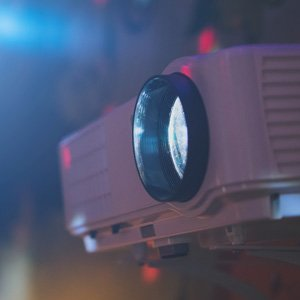 close up of a projector for hire with light beam