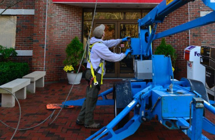 professional power washing staff with the latest equipment