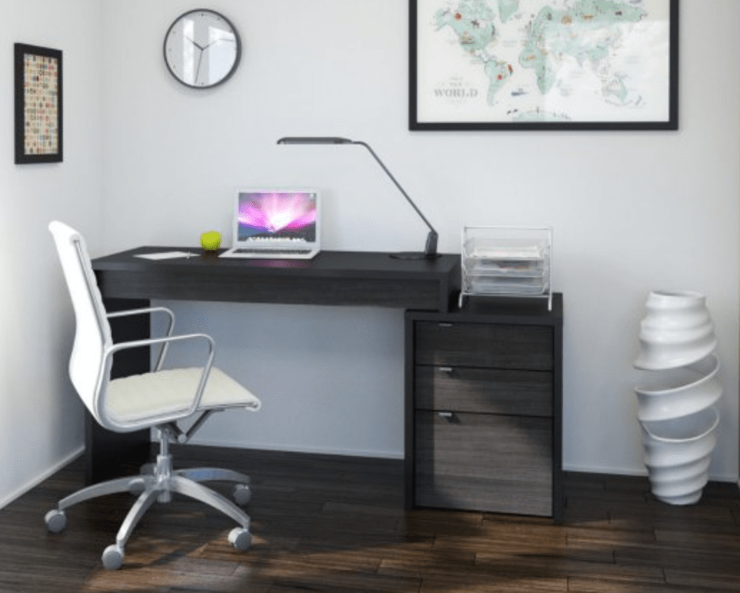 Built in filing cabinets help shape office organization.