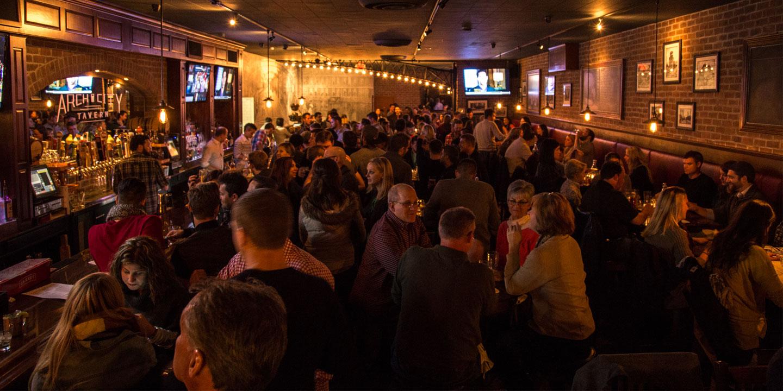 crowded arch city tavern interior