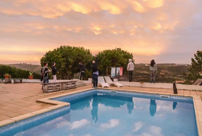 villa pool at sunset