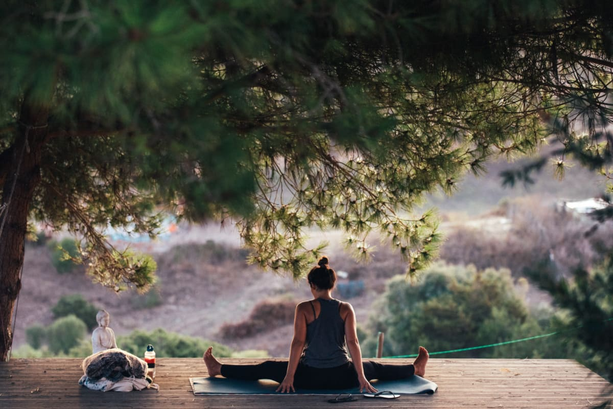 yoga teacher practicing in the nature