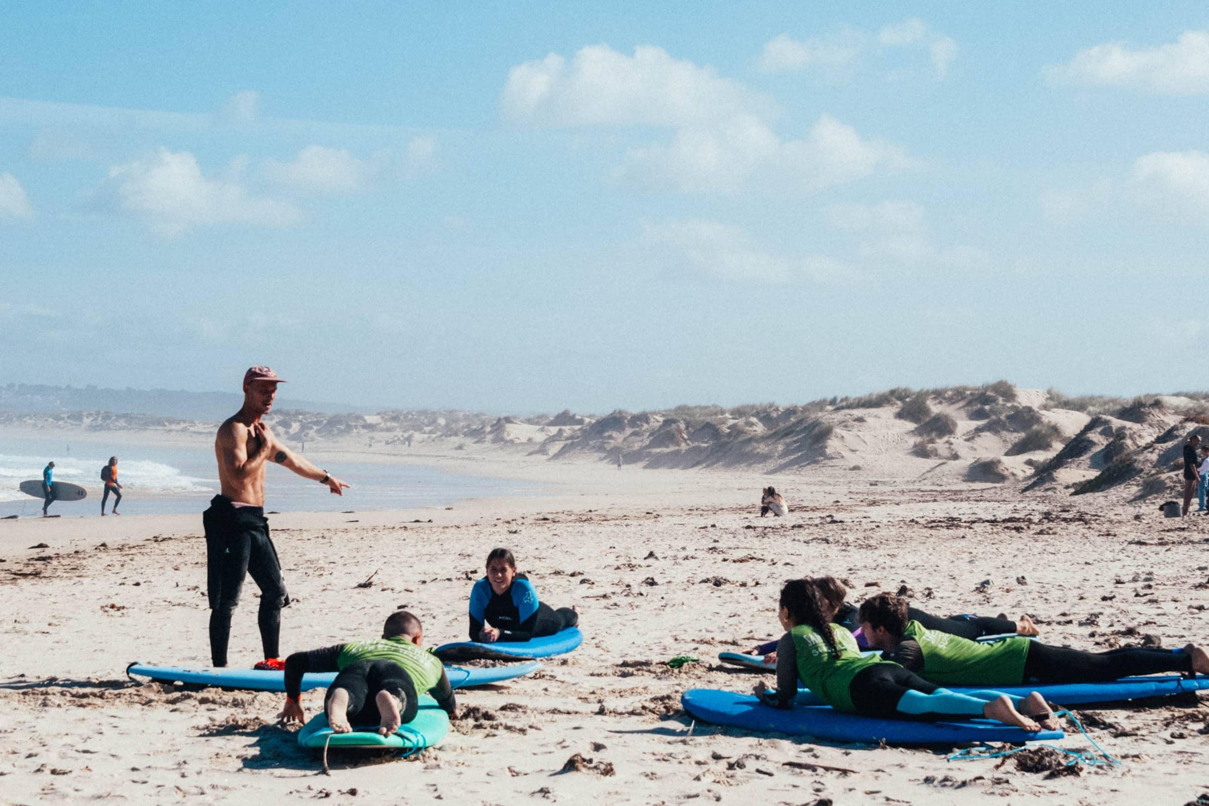 santa cruz surf coaches teaching beginner surfers on the beach