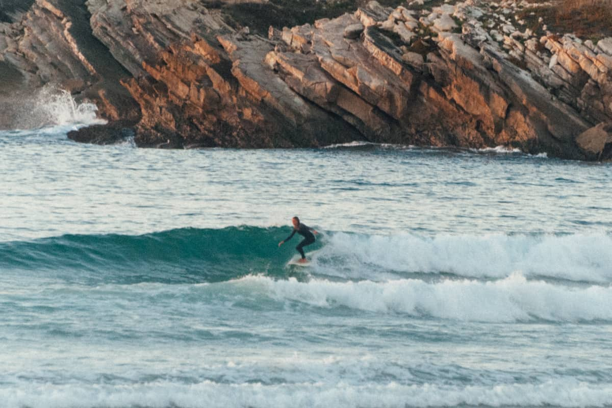 Girl surfing Portugal