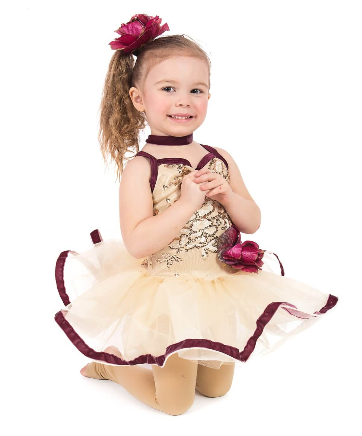 Girl in dance recital outfit