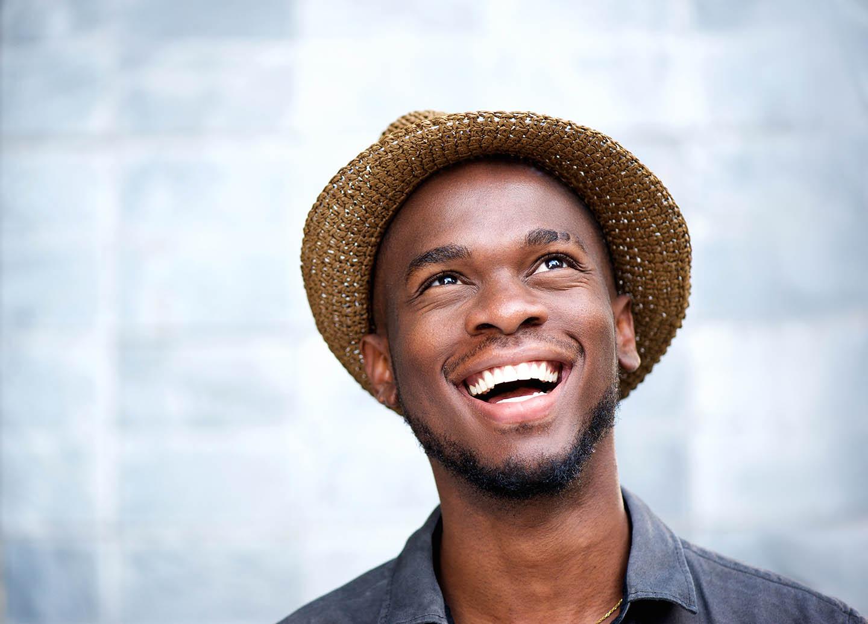 Man smiling towards the sky