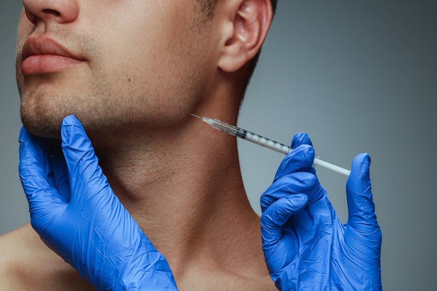 patient receiving fillers in the jawline