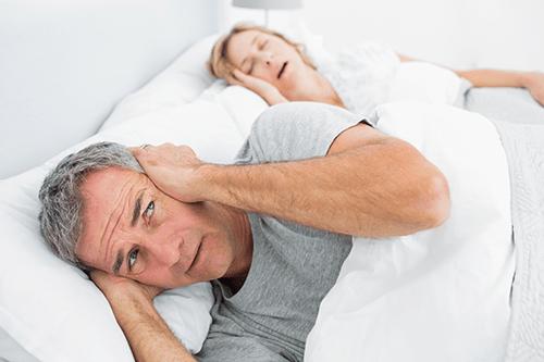 Couples suffering with sleep deprivation due to sleep apnea.