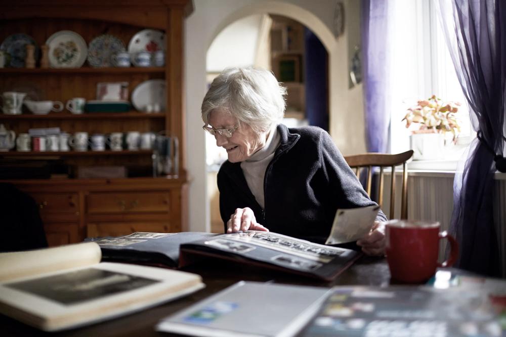 elderly woman photo album
