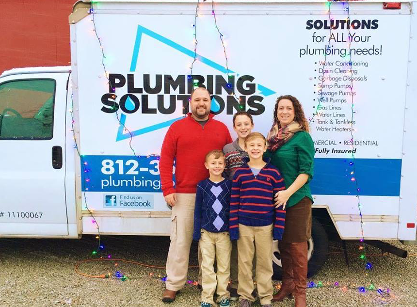 brandon wormer founder of plumbing solutions with his family