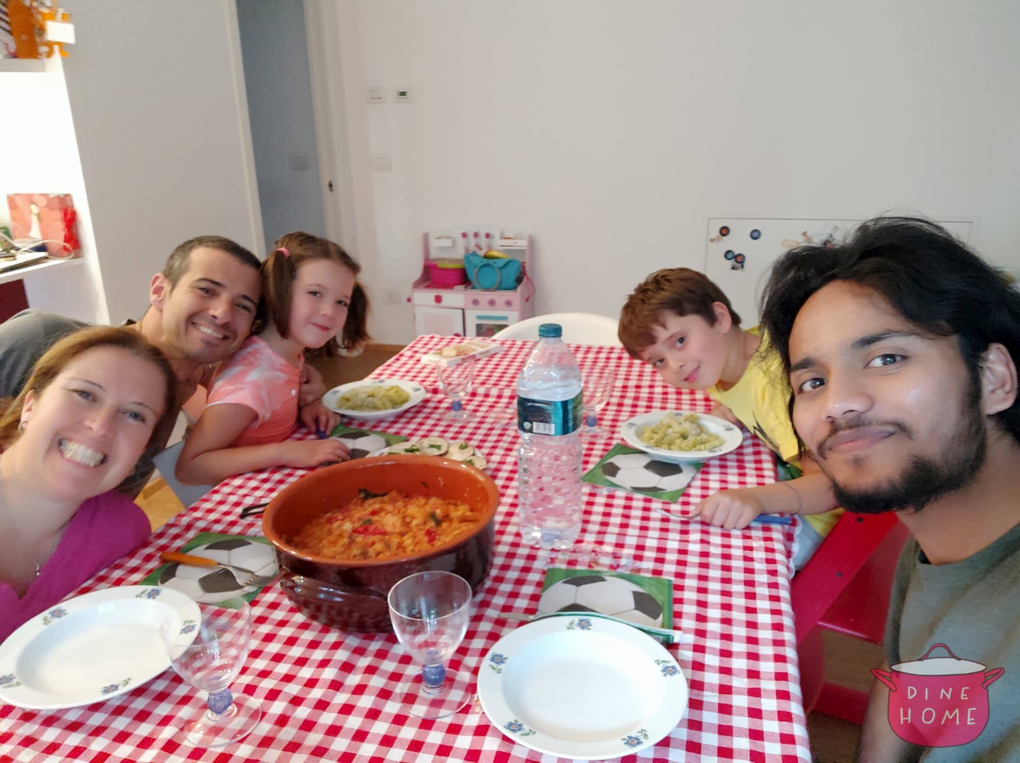 Omar, Indian student, having dinner with his Dinehome family.