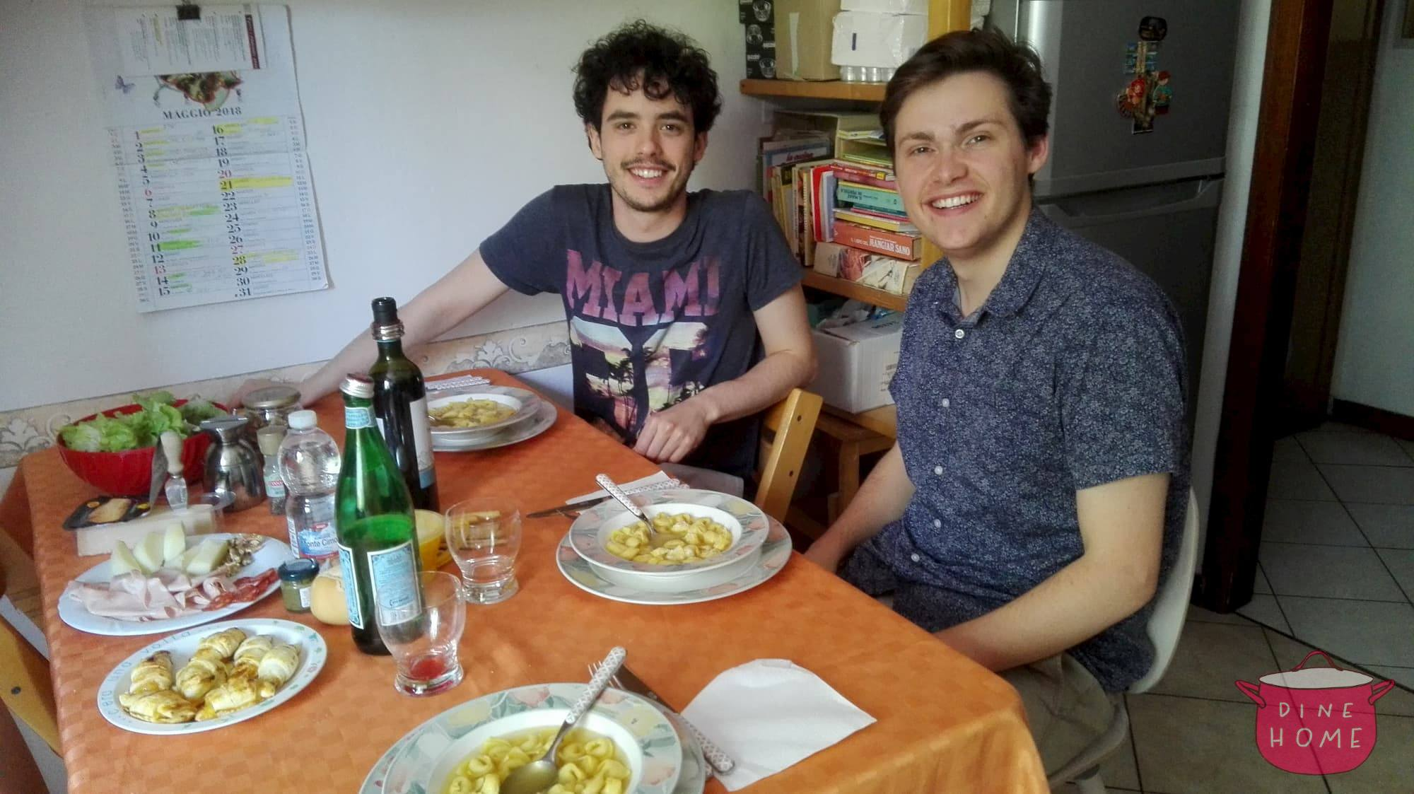 Simon, a U.S. student, having dinner with his Dinehome family.