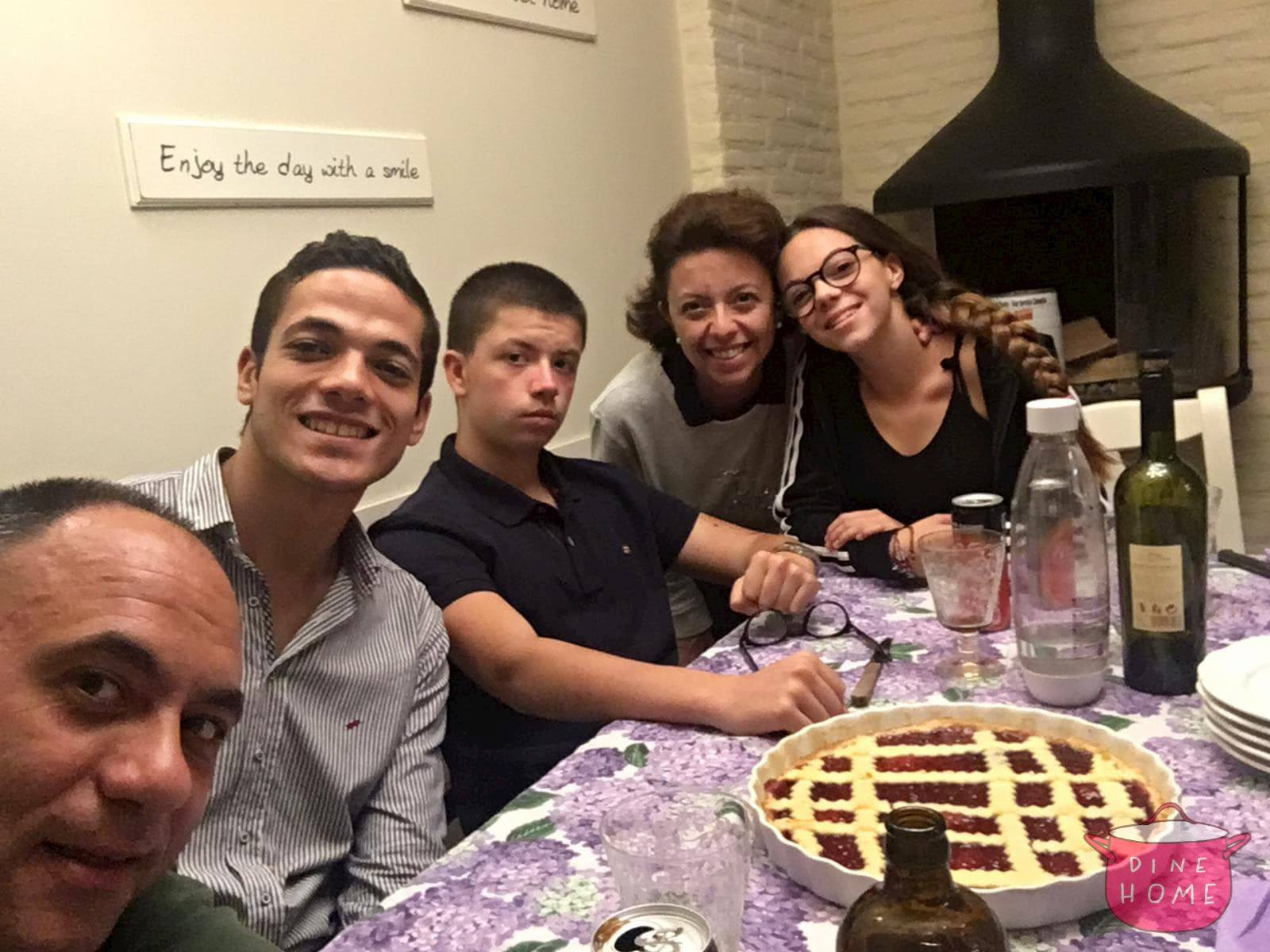 Ahmed, Egyptian student, having dinner with his Dinehome family.