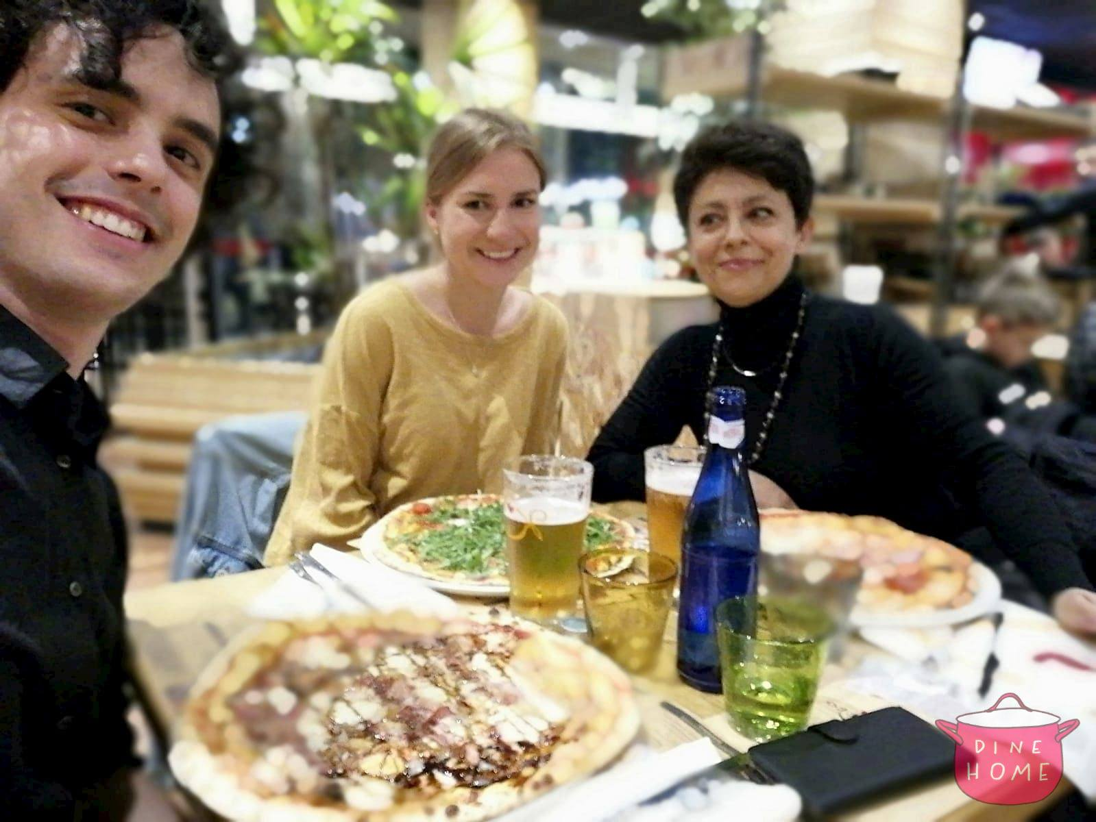 Magdalena, a student from Germany, having dinner with her Dinehome family.