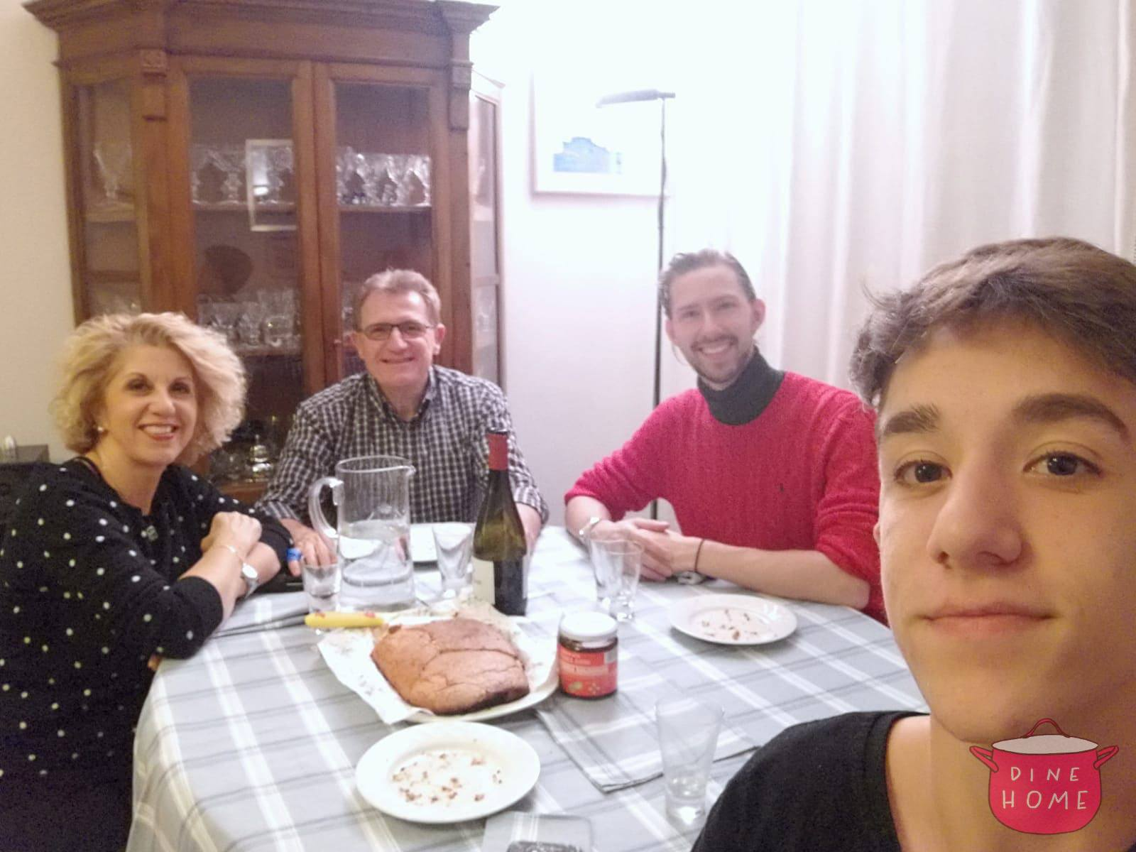 Kyle, student from the U.K., having dinner with his Dinehome family.