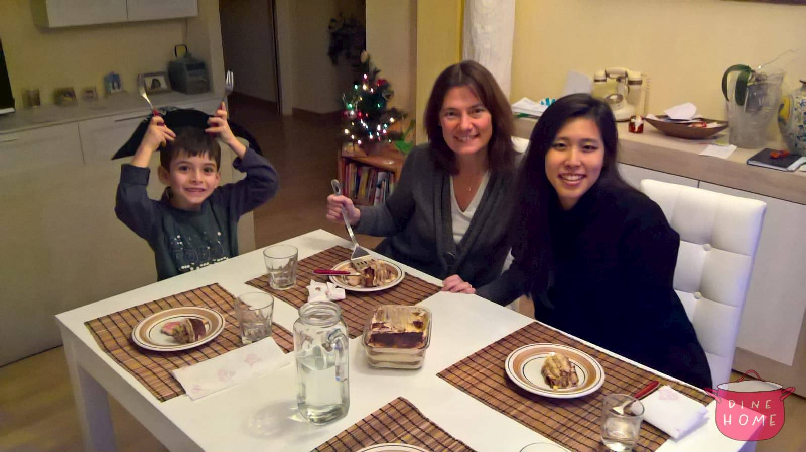 Hyo, a student from South Korea, having dinner with her Dinehome family.