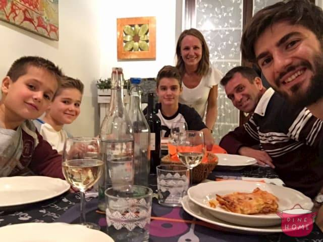 Abdurrahman, a student from Turkey, having dinner with his Dinehome family.