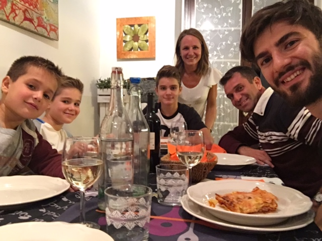 Italian host family having dinner with an international student