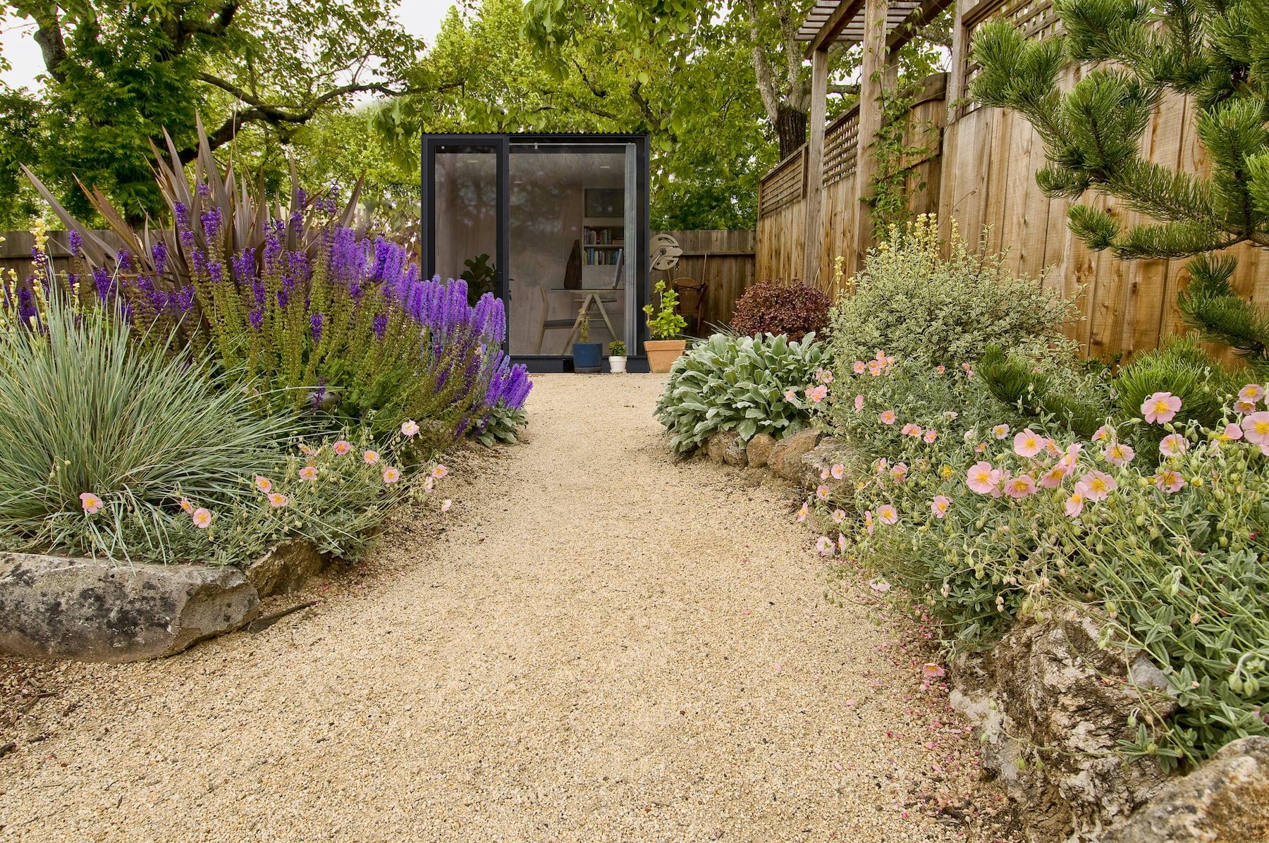 A backyard office set inside a desert garden