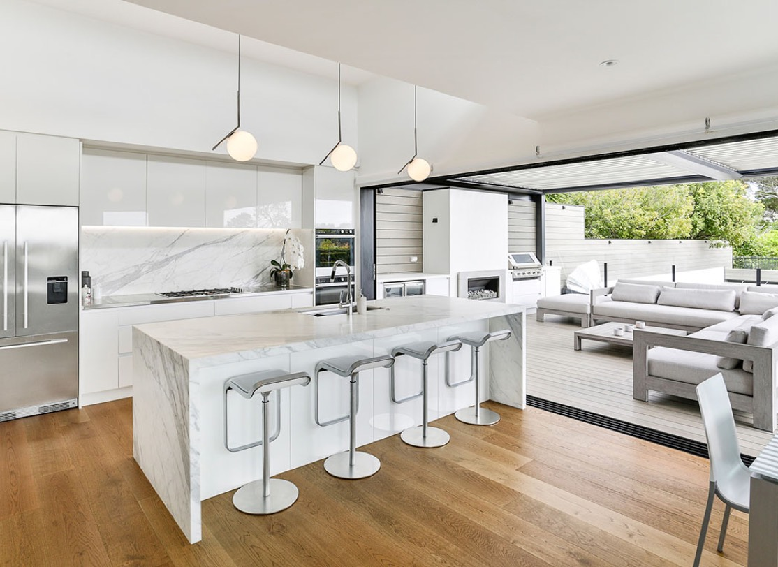 Modern white kitchen with bar stool set up