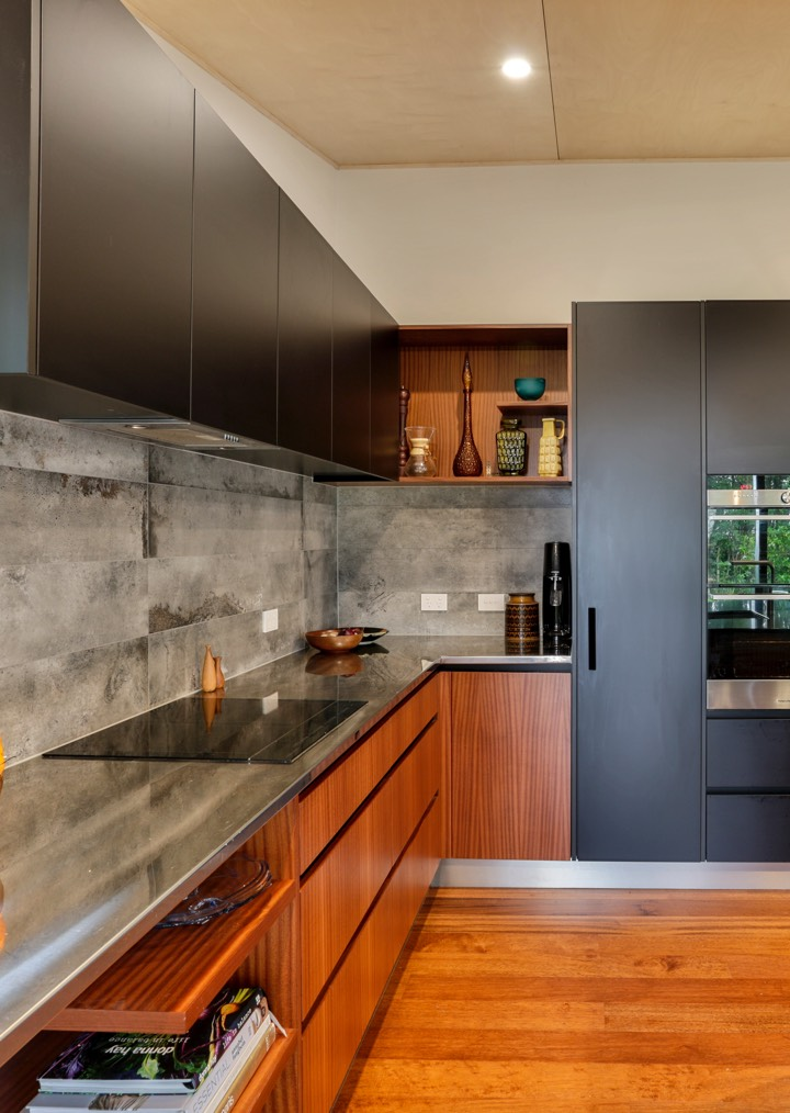 Wooden and black kitchen with cement tiling
